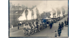 Double exposure of a funeral procession, described in the caption